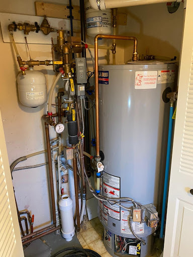 A conventional hot water tank.